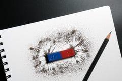 Röd och blå stångmagnet eller fysik magnetisk, blyertspenna- och järnpow Arkivbilder
