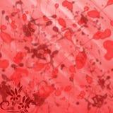 Röd och burgundy bakgrund med fläckar och målarfärg plaskar med små blommor i hörnet Arkivbilder