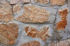 Röd och grå bakgrund för stenvägg, texure av den moderna stildesignen, kopieringsutrymme arkivbild