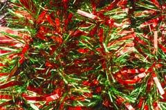 Röd och grön julgirland Arkivbild