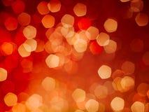 Röd och gul bakgrund för bokehljustappning Royaltyfria Bilder