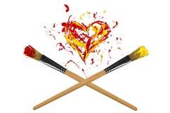 Röd och gul hjärta och två korsade målarpenslar Arkivbilder