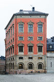 Röd och smyckad slott som byggs för kanslern Axel Oxenstierna i Stockholm Arkivfoton