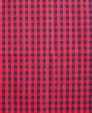 Röd och svart bordduk. Arkivbilder
