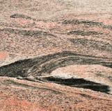 Röd och svart granit Arkivfoto