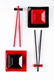 Röd och svart sushiuppsättning royaltyfri bild