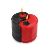 Röd och svart Yin Yang handgjord stearinljus arkivbilder