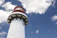 Röd och vit fyr i Topo, Sao Jorge, Azores portugal Royaltyfria Foton