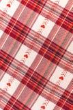 Röd och vit rutig bakgrund för en vintervykort valentin för dag s Arkivfoton