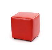Röd ottoman för läderfotstol royaltyfri fotografi
