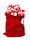 Röd påse mycket av julgåvor Fotografering för Bildbyråer