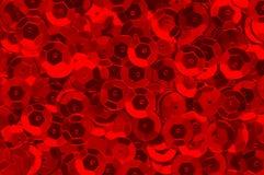 Röd paljettbakgrund Arkivfoto