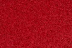 Röd pappers- bakgrund, makroskott Arkivbilder
