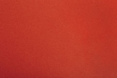Röd pappers- pergamentbakgrund med fibrer Royaltyfria Bilder