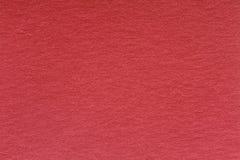 Röd pappers- textur, kan användas som bakgrund Arkivfoto