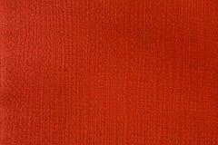 Röd pappers- textur med att utföra i relief och stämpling royaltyfria foton