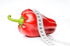 Röd peppar i måttband Royaltyfria Bilder