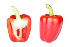 Röd peppar och halvt snitt som isoleras på vit Royaltyfria Foton