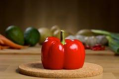 Röd peppar på en trätabell Royaltyfri Bild