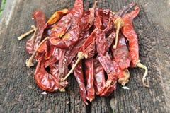 Röd peppar på wood bakgrund Fotografering för Bildbyråer