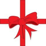 Röd pilbåge för julgåva Arkivbild