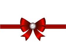 Röd pilbåge med prydnaden Royaltyfri Foto
