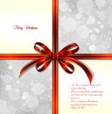 Röd pilbåge på en magical julbakgrund. Vektor Fotografering för Bildbyråer