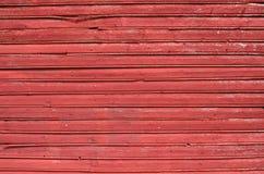 Röd plankavägg Arkivbild