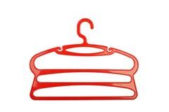 Röd plast- för klädhängare Arkivbild