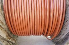 Röd plast- kabel royaltyfria foton