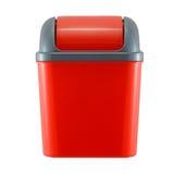 Röd plast- soptunna på vit Arkivfoto