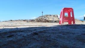 Röd plast- stol Arkivfoto