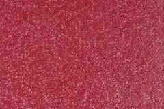 Röd präglad dekorativ konstlädertexturbakgrund, slut upp Arkivfoton