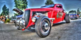 Röd racerbil för tappning Arkivbild