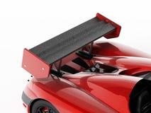 Röd racerbil med kolfiberspoiler illustration 3d Royaltyfri Foto