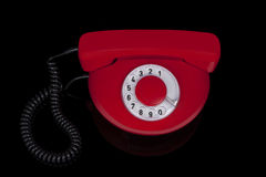 Röd retro telefon. Fotografering för Bildbyråer