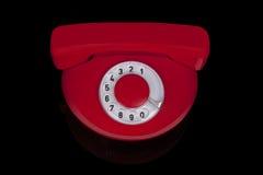 Röd retro telefon. Arkivfoto