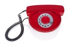 Röd retro telefon. Arkivbild