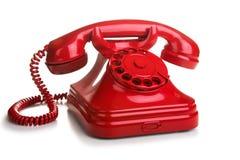 Röd retro telefon på vit bakgrund Royaltyfria Bilder