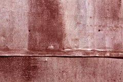 Röd riden ut textur för metallark Royaltyfria Foton