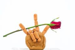 Röd ros i teckenspråk Arkivfoto