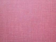 Röd rosa backround - gammal kanfas - lagerföra fotoet Arkivbild
