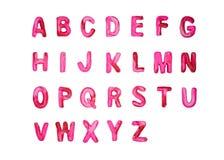 Röd rosa plasticinealfabetA-Z royaltyfria bilder