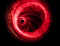 röd roterande virvel för design royaltyfria foton