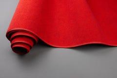 röd rullning för matta upp Royaltyfri Fotografi