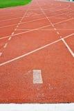 Röd running lane för nummer 1 Arkivfoton