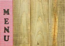 Röd rutig MENYgräns på lantligt wood tecken Royaltyfria Foton
