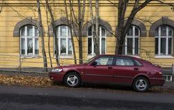 Röd Saab parkering Royaltyfria Foton