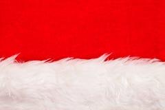 Röd sammetbakgrund med den vita fluffiga gränsen Arkivfoton