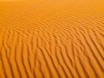 röd sandtextur Arkivfoto